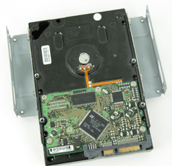"""Adapter bracket attached to a 3.5"""" SATA hard drive."""