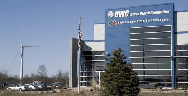(OWC Headquarters in Woodstock, IL, showing the company's wind turbine)