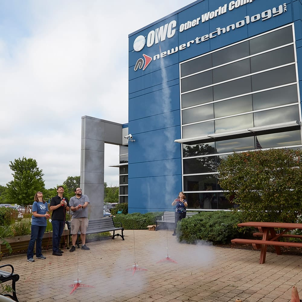 Larry O'Connor and Jen Soule launch model rockets at OWC headquarters in Woodstock, Illinois