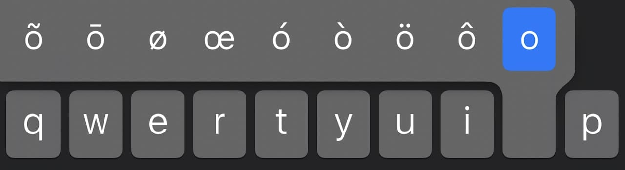 Tap and hold the O key to see the different accented variations of the letter