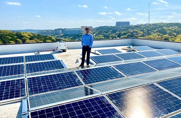 Picture of OWC CEO Larry O'Connor inspecting the SunPower solar array in Austin, TX.