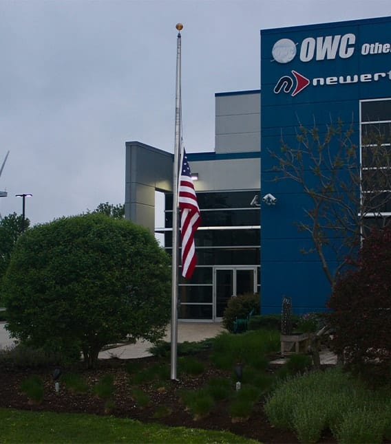 OC Headquarters in Woodstock, IL with a flag at half-mast
