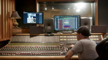 Dave Kalmusky in the studio remotely recording a singer