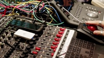OWC Envoy Pro Elektron External SSD on a Mixing Board in a Recording Studio