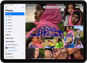 4th generation iPad Air showing photos app with women