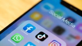 iPhone 11 Pro showing Social media applications on its screen