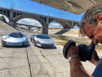 Evan Klein photographing two cars